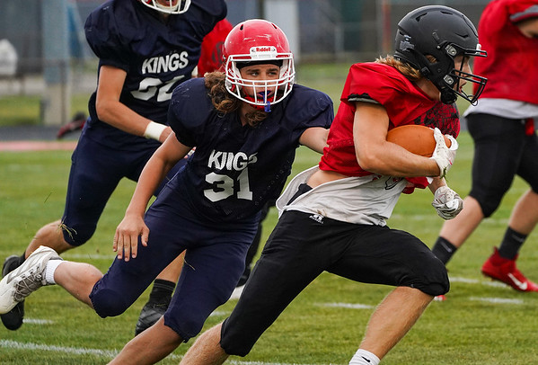 Lewis Cass Kings defenseman Wyatt Loos (31) attempts a tackle during a preseason scrimmage against the Southwood Knights at Lewis Cass Jr./Sr. High School in Walton on Friday, Aug. 13, 2021.