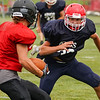 A Lewis Cass Kings defenseman goes to tackle a Southwood Knights player during a preseason scrimmage against the Southwood Knights at Lewis Cass Jr./Sr. High School in Walton on Friday, Aug. 13, 2021.