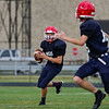 Lewis Cass Kings' Griffin Wolf (10) rolls out of the pocket as a receiver looks to him during a preseason scrimmage against the Southwood Knights at Lewis Cass Jr./Sr. High School in Walton on Friday, Aug. 13, 2021.