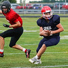 Lewis Cass Kings tight end Wyatt Loos (31) turns upfield after making a catch during a preseason scrimmage against the Southwood Knights at Lewis Cass Jr./Sr. High School in Walton on Friday, Aug. 13, 2021.
