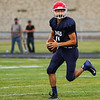 Lewis Cass Kings quarterback L.J. Hillis (11) rolls out fo the pocket during a preseason scrimmage against the Southwood Knights at Lewis Cass Jr./Sr. High School in Walton on Friday, Aug. 13, 2021.