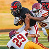 A Logansport Berries running back tries to break a couple McCutcheon Mavericks tackles during the first half of an NCC game at Logansport Memorial Hospital Stadium in Logansport on Friday, Sept. 17, 2021.