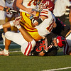 Logansport Berries linebacker Grayson Long (35) tackles McCutcheon Mavericks quarterback Owen Smith (11) during the first half of an NCC game at Logansport Memorial Hospital Stadium in Logansport on Friday, Sept. 17, 2021.