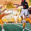 Logansport Berries linebacker Grayson Long (35) and linebacker Gavin Barron (29) block a punt attempt by McCutcheon Mavericks punter Reece Dunbar (49) during the first half of an NCC game at Logansport Memorial Hospital Stadium in Logansport on Friday, Sept. 17, 2021.