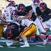 Logansport Berries defensive players tackle a McCutcheon Mavericks player during the first half of an NCC game at Logansport Memorial Hospital Stadium in Logansport on Friday, Sept. 17, 2021.