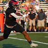 Logansport Berries tight end Amari Gittings (1) runs the ball of a game between the Logansport Berries and Peru Tigers at Berry Stadium in Logansport on Friday, Aug. 20, 2021.