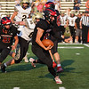 Logansport Berries quarterback Izak Mock (11) runs during the first half of a game between the Logansport Berries and Peru Tigers at Berry Stadium in Logansport on Friday, Aug. 20, 2021.