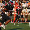 Logansport Berries tight end Amari Gittings (1) runs the ball during the first half of a game between the Logansport Berries and Peru Tigers at Berry Stadium in Logansport on Friday, Aug. 20, 2021.