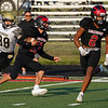 Logansport Berries returner John Scott (13) runs the ball during the first half of a game between the Logansport Berries and Peru Tigers at Berry Stadium in Logansport on Friday, Aug. 20, 2021.