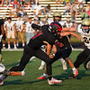 Logansport Berries quarterback Izak Mock (11) runs the ball during the first half of a game between the Logansport Berries and Peru Tigers at Berry Stadium in Logansport on Friday, Aug. 20, 2021.