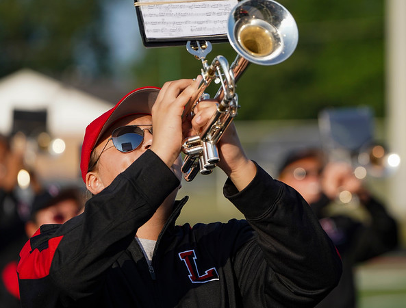 Sheet music is captured in the sunglasses of a Berry Band player before a game between the Logansport Berries and Peru Tigers at Berry Stadium in Logansport on Friday, Aug. 20, 2021.