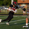Logansport Berries running back Gavin Barron (29) gets the hand off during the first half of a game between the Logansport Berries and Peru Tigers at Berry Stadium in Logansport on Friday, Aug. 20, 2021.