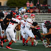 Richmond Red Devils running back Demarco Owens (11) is tackled by Logansport Berries players during the first half of a game at Logansport Memorial Hospital Stadium in Logansport on Friday, Sept. 24, 2021.