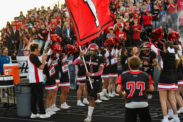 Logansport Berries linebacker Amari Gittings (1) leads the team out fo the tunnel before a game against the Richmond Red Devils at Logansport Memorial Hospital Stadium in Logansport on Friday, Sept. 24, 2021.