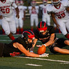 Logansport Berries players go to recover a blocked punt during the first half of a game at Logansport Memorial Hospital Stadium in Logansport on Friday, Sept. 24, 2021.