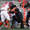 Logansport Berries linebacker Grayson Long (35) tackles Richmond Red Devils running back Demarco Owens (11) during the first half of a game at Logansport Memorial Hospital Stadium in Logansport on Friday, Sept. 24, 2021.