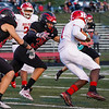 Logansport Berries linebacker Grayson Long (35) goes to make a tackle on Richmond Red Devils wide receiver Marquis Johnson (1) during the first half of a game at Logansport Memorial Hospital Stadium in Logansport on Friday, Sept. 24, 2021.