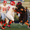 Logansport Berries defensive players stop Richmond Red Devils running back Demarco Owens (11) during the first half of a game at Logansport Memorial Hospital Stadium in Logansport on Friday, Sept. 24, 2021.