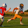 Pioneer Panthers quarterback Brock Robinson (10) returns a kick during a game at Caston High School in Fulton on Friday, Sept. 10, 2021.