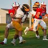 Pioneer Panthers quarterback Brock Robinson (10) is tackled by Caston Comets linebacker Cain Schanlaub (65) during a game at Caston High School in Fulton on Friday, Sept. 10, 2021.