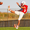 Caston Comets punter Landon Shafer (4) kicks the ball during a game at Caston High School in Fulton on Friday, Sept. 10, 2021.
