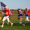 Caston Comets run onto the field during a game at Caston High School in Fulton on Friday, Sept. 10, 2021.