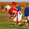Caston Comets fullback Sam Smith (5) scoops a kick during a game at Caston High School in Fulton on Friday, Sept. 10, 2021.