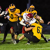 Pioneer Panthers linebacker Owen Miller (67) tackles a player during the first half of a game at the Pit in Royal Center on Friday, Oct. 1, 2021.