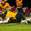 Pioneer Panthers linebacker Logan Smith (2) recovers a fumble during the first half of a game at the Pit in Royal Center on Friday, Oct. 1, 2021.