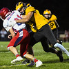 Pioneer Panthers defensive back Beau Mersch (3) makes a tackle during the first half of a game at the Pit in Royal Center on Friday, Oct. 1, 2021.