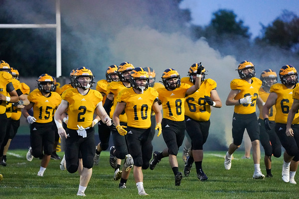Pioneer Panthers players run onto the field before a game against the Knox Redskins at the Pit in Royal Center on Friday, Oct. 1, 2021.