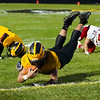 A Pioneer Panthers player is tripped up during the first half of a game at the Pit in Royal Center on Friday, Oct. 1, 2021.