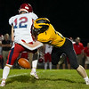 Pioneer Panthers linebacker Logan Smith (2) strips Knox Redskins quarterback Cohen Watson (12) during the first half of a game at the Pit in Royal Center on Friday, Oct. 1, 2021.