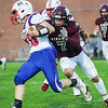 Winamac Warriors linebacker Xavier Holehan (7) goes to tackle Caston Comets wide receiver Evan Howard (20) during the first half of an HNAC game at Roudebush Field in Winamac on Friday, Oct. 8, 2021.