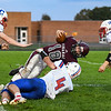 Winamac Warriors running back Hayden Clark (18) is tackled by Caston Comets linebacker Landon Shafer (4) after making a catch during the first half of an HNAC game at Roudebush Field in Winamac on Friday, Oct. 8, 2021.