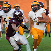 Pioneer Panthers running back Beau Mersch (3) attempts to avoid a tackle during an HNAC game between the Winamac Warriors and Pioneer Panthers at Winamac High School on Friday, Aug. 27, 2021.