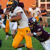 Pioneer Panthers running back Beau Mersch (3) breaks a tackle by Winamac Warriors defensive back Russell Compton (12)during an HNAC game between the Winamac Warriors and Pioneer Panthers at Winamac High School on Friday, Aug. 27, 2021.