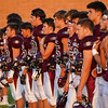 Winamac Warriors players wait for the national anthem before an HNAC game between the Winamac Warriors and Pioneer Panthers at Winamac High School on Friday, Aug. 27, 2021.