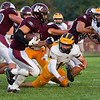 Players compete during an HNAC game between the Winamac Warriors and Pioneer Panthers at Winamac High School on Friday, Aug. 27, 2021.
