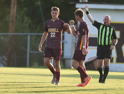 Russell's Blake Hern congratulates Nathan Totten after scoring a goal against Fleming County on Thursday evening at Russell.  MARTY CONLEY/ FOR THE DAILY INDEPENDENT