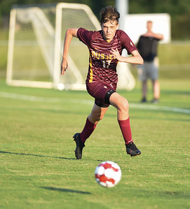 Preston Guza of Russell sprints to the ball against Fleming County on Thursday evening at Russell.  MARTY CONLEY/ FOR THE DAILY INDEPENDENT