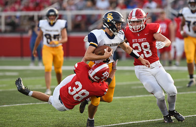 Boyd County's Aaron Weis and Jacob Barrett stop South Point quarterback, Jordan Ermalovich on Friday evening at Boyd County.  MARTY CONLEY/ FOR THE DAILY INDEPENDENT