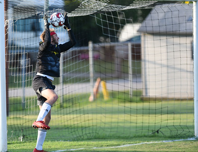 Flemiing County goalkeeper, Brodie Knarr makes a save against Russell on Thursday evening at Russell.  MARTY CONLEY/ FOR THE DAILY INDEPENDENT