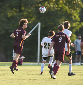 Russell's Nathan Sabotchick hits a header against Fleming County on Thursday evening at Russell.  MARTY CONLEY/ FOR THE DAILY INDEPENDENT