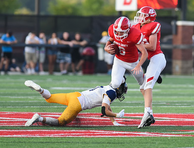 Boyd County's Jacob Meade is tripped up by South Point's Malik Pegram on Friday evening at Boyd County.  MARTY CONLEY/ FOR THE DAILY INDEPENDENT