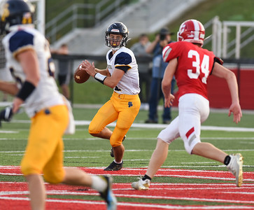 South Point quarterback, Jordan Ermalovich rolls out to pass as Boyd County's Jack Hogston pressures on Friday evening at Boyd County.  MARTY CONLEY/ FOR THE DAILY INDEPENDENT