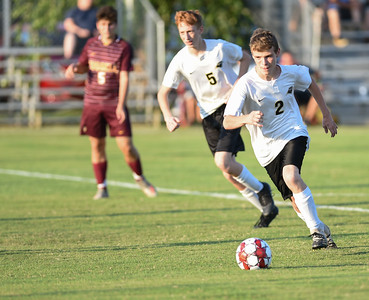 Cole Conley of Fleming County dribbles the ball upfield against Russell on Thursday evening at Russell.  MARTY CONLEY/ FOR THE DAILY INDEPENDENT