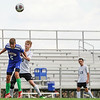 Caston Comets defender Rowan Jellison (5) heads the ball during the first half of a game at Caston High School in Fulton on Tuesday, Sept. 14, 2021.