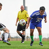 Caston Comets midfielder Edgar Aguilar-Mendez (21) kicks the ball during the first half of a game at Caston High School in Fulton on Tuesday, Sept. 14, 2021.