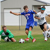Caston Comets defender Rowan Jellison (5) scores a goal during the first half of a game at Caston High School in Fulton on Tuesday, Sept. 14, 2021.